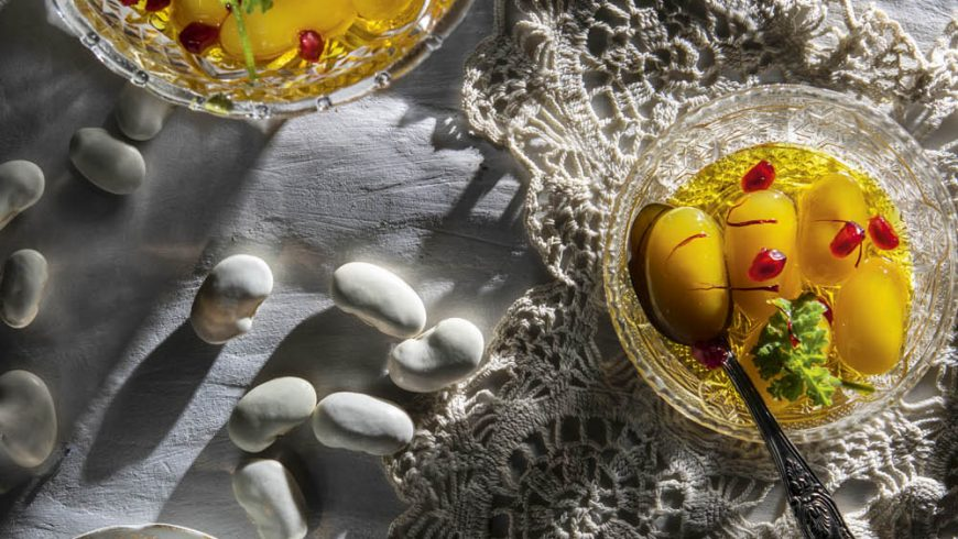 Dessert spoon beans giant with pomegranate and crocus of Kozani
